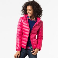 This warm down jacket is incredibly thin and lightweight with a high collar and hood. The outer lining resists water, and water-repellent thread prevents moisture from entering through seams. It features a nice sheen finish in vibrant colors for a sporty look and an attractive, feminine silhouette. The edges are reinforced for durability. Elastic at the cuffs and waist keeps out cold wind. Carries easily in its compact pouch.