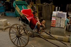 Hand-pulling rickshaw -a common sight to behold in Kolkata, #Bengal. It is an identity of the city.