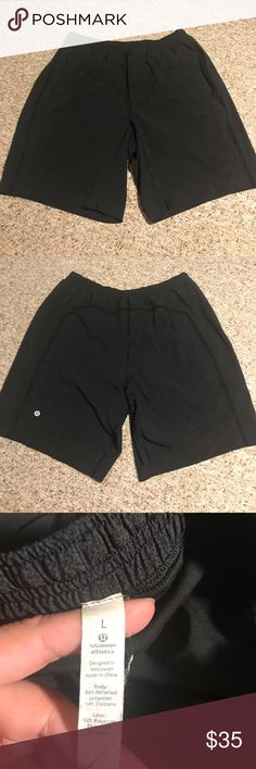 Lululemon athletica Men's athletic shorts Lululemon athletica Men's athletic shorts. They are black in color, mesh down the sides, built in shorts for comfort and a draw string. lululemon athletica Shorts Athletic