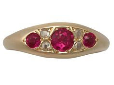 'Synthetic Ruby and Diamond Cocktail Ring - Antique' http://www.acsilver.co.uk/shop/pc/Synthetic-Ruby-and-0-12-ct-Diamond-18-ct-Yellow-Gold-Dress-Ring-Antique-1913-35p9132.htm