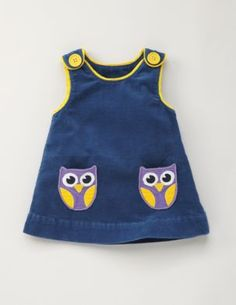 Owl pockets - This looks like something my Grandma would have made me to wear when I was little.  Wish I knew how to sew something like this!