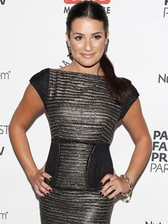 Lea Michele rocks this sophisticated neckline and covered shoulders. Her pony tail is pulled together and sleek.