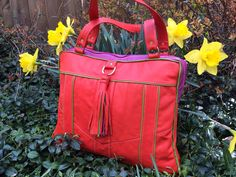 ReFind Originals custom made bag. Made from upcycled leather jackets in bright Spring colors.