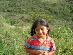 A girl in a field in Peru.
