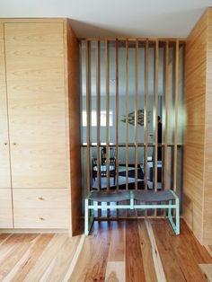 room divider - slats work like a window and let in light from one room to next (entry way possibility)