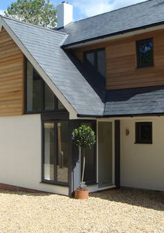 like the grey windows / cladding / slate roof / white render combination More: - Modern Design Roof Cladding, Cedar Cladding, House Cladding, Exterior Cladding, Facade House, Cladding Ideas, Weatherboard Exterior, Wooden Cladding, Bungalow Extensions