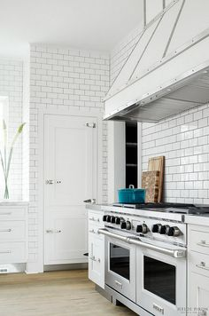 Kitchen clad in subway tile