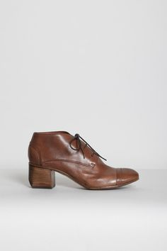 Perfect.  Cognac leather, cap-toe brogue ankle bootie - with a sculpted wood heel. | Costume National, Agata