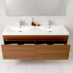 With clean lines and a contemporary look, this bathroom vanity is a great piece for minimalist or modern bathroom settings. This Fresca Largo vanity features two handy drawers that keep your bathroom