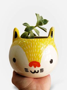 http://www.collector55.com.br/vaso-artesanal-gato-amarelo/p