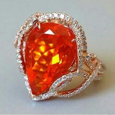 Fire opal and diamonds ring