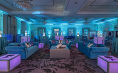 The lounge was the perfect spot to relax after dancing all night. Purple LED tables and custom cushions featured Jules' silhouette logo in the seating area along with custom plush turquoise sofas, sequined cushions and a gorgeous silver ottoman in the center.  Turquoise and Purple Teen lounge with custom printed graphics, LED tables and plush party rentals by X-Quisite Flowers & Events in Westchester  See more photos from this #BatMitzvah…