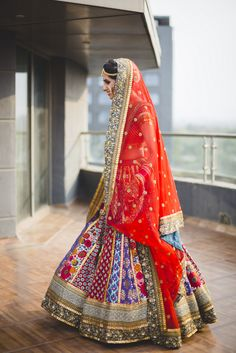 So if you follow us, you know we have a fare share of Sabya sightings and honestly, they can tend to get cliched. But this bride  really took her look up a notch with a unique color palette and beautiful styling - unlike one we have seen in a long time  . Nikhil, the director of a digital marketing