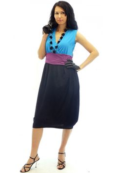 Dress in three colors with sharp cleavage. The dress is with length to under the knees.