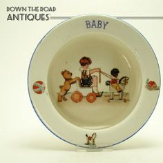 This baby plate depicts a little girl pushed by a dog and pulled by a Gollywog on a toy horse. It's a very cute depiction.No chips or