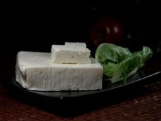 Feta is a pickled curd cheese that has a salty and tangy taste enhanced by the brine solution. The texture depends on the age which can be extremely creamy, or crumbly dry.