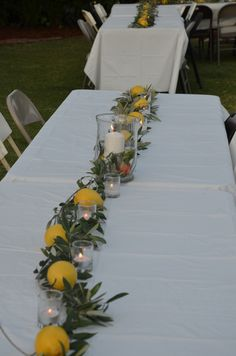 Table decor: olive branches, lemons, candles. Simple.