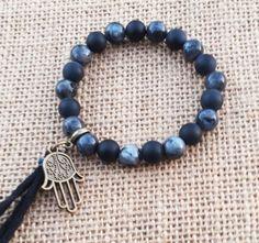 Check out this item in my Etsy shop https://www.etsy.com/uk/listing/275183088/hamsa-bracelet-tassel-mens-bracelet