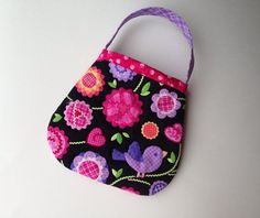 Darling!  Toddler purse quilted in pink and purple by PotatoBlossomStudio