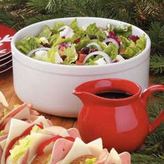 Festive Tossed Salad. I Use grape tomatoes and add slivered almonds or pecans. for dressing just use good seasons mild italian made with red wine vinegar and 2 tbs. sugar and a little extra water..