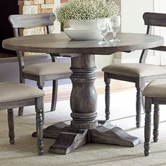 Set the foundation for your stylish entertaining space with this timeless dining table. Brimming with French country charm, this design is crafted of solid and rubber wood with a distressed dove gray finish. It offers up a pedestal design and features an intricately curved and ribbed details. Once you've pulled up a few side chairs and set a wrought iron chandelier overhead, you're ready to serve up festive family feasts and elegant dinner parties alike. With a weathered look, it'...