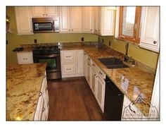 Golden Crystal granite and white cabinets.