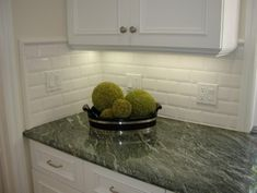 dark green granite with white cabinets
