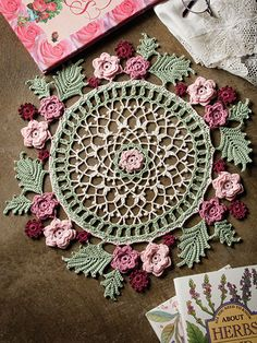 "An elegant ring of roses surrounds this intricate doily that exudes style and grace. Includes written instructions only. This e-pattern was originally published in Irish Beauty Doilies. Size: 17 3/4"" in diameter. Made with size 10 crochet cotton and size 7/1.65mm steel hook. Skill Level: Intermediate"