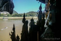 Buddha Statues overlooking the Mekong River from Pak Ou Caves in Laos.