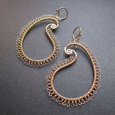 Kashmir 11 Hammered paisley earring wrapped with tiny loops. $120.00, via Etsy.