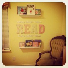 """I uploaded this from my phone but I finished the girls reading corner in the play room I love it! :) it's to focus on reading and our top fav books of the week DIY wood letters and I just put scrapbook paper over them for the word""""read"""" I found all the other words from michaels and then spray painted two shelfs found at Ross easy and cute! :)"""