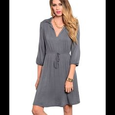 Gray Dress This knit mid-length dress features a collared split neckline with cinched drawstring waistline. Blouson style quarter sleeve cuffs. Delirious  Dresses Midi
