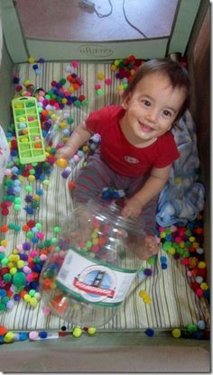 Great toddler sensory activities to keep the little ones busy...such as pom poms, tongs, and buckets