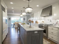 White cabinets and grey island. Creating French Country in the Texas Suburbs : On TV : Home & Garden Television