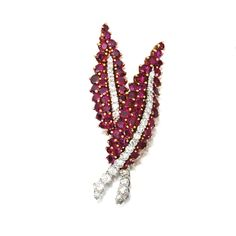 An 18 Karat Gold, Platinum, Ruby and Diamond Brooch, Van Cleef & Arpels,  New York, Circa 1960  The two leaves set with numerous round rubies weighing approximately 9.00 carats, further set with 37 round diamonds weighing approximately 2.60 carats, signed VCA, numbered NY38136.
