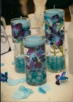 Orchids and candles gerber daisies, idea, floating candles, centre pieces, colors, candle centerpieces, flowers, blues, tea lights