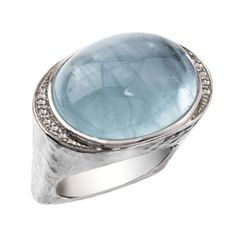 14kt white gold ring finished with an oval aqua and diamonds. A Jorge Adeler original design.
