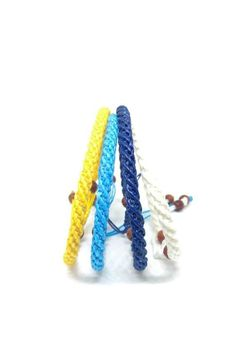 The SPIRAL Simple Beaded Handmade Braided Waxed Cotton Classic Skinny Wristband Bracelet Primary Colors, Color Combos, Spiral, Braids, Colours, Skinny, Chiang Mai, Simple, Classic