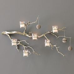 I am in love with this branch and candle wall art from West Elm. I love that it can be used year round and can also have a touch of Christmas by simply hanging ornaments from it. Hopefully I can find a knock-off version somewhere!