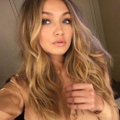 Gigi Hadid hair blonde dirty blonde color hair curls km