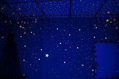 "hrymd: "" Glow in the dark stars hanging in a black light room with see through string. """