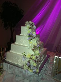 Waterfall of flowers and the up lighting adds so much to this design! Petals by Design (Laura)