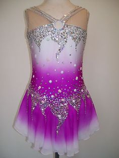 Gorgeous new ice skating/twirling baton dress.  It is fully lined and comes with a matching hair scrunchie.  You'll love this dress. Material will stretch up to 2 inches.  If you would like to customize this dress to your measurements, please let me know.  The cost is $120. First class shipping and handling fees: USA is $11.95, Canada is $14.95, Worldwide is $19.95. Wonderland0559 on eBay. Item number 230788544927. Replace acrylic stones with Swavorski's.