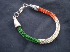 VIKING KNIT Irish Flag Bracelet/Anklet - 6 3/4 inch Green, Silver and Orange Colored Copper - Single Weave. $12.25, via Etsy.