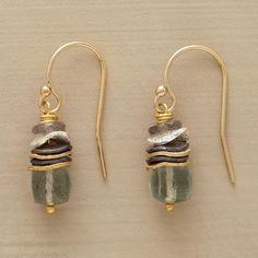 "DISCUS EARRINGS -- In these labradorite bead and aquamarine earrings, wavy disks of sterling silver and 18kt goldplate join labradorite and moss aquamarine. 14kt goldfilled French wires. Bead size may vary. Exclusive. Handmade in USA. 7/8""L."
