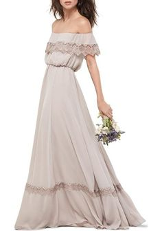 inna off the shoulder chiffon blouson gown by WTOO. A band of scalloped lace at the ruffle-draped bodice and near the sweeping hem adds that extra dash of romance to a charming chiffon gown. Designed to show off lovely shoulders, the style is universally flattering in a blouson A-line cut... #wtoo #dresses #gowns