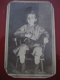 This little boy is holding a hammer, which symbolizes work left undone.  --  Victorian Post Mortem