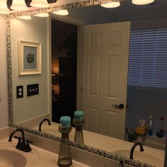 Our bathroom mirror was just plain and lacked that wow factor! I had thought about doing wood trim but, that didn't tickle my fancy either. I had tiled our fire…