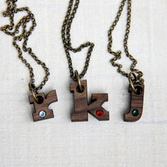 You choose the letter and the birthstone. Birthstone necklace by TinyWhaleStudio on Etsy, $18.00 Tiny Whale Studio