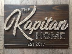 "Made to order, handcrafted Name string art wall sign. Constructed on solid pine. Dimensions are approx 24""x16"". Pictured is Chocolate stain with Natural white string. Other stain options are Tuscan, Weathered Grey, or Antique Aqua. String options are endless! Just let me know what"